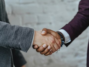 Two hands clasped in handshake