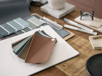 Leather swatches and clipboard on the table