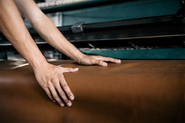 Hands on unrolled leather