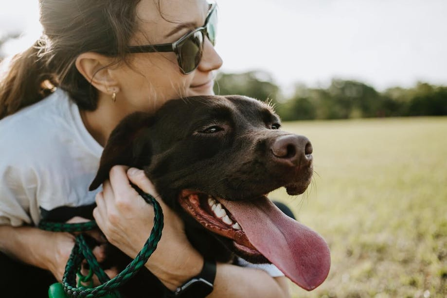 Woman showing affection to her dog