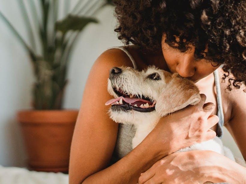 Woman hugging dog for emotional support