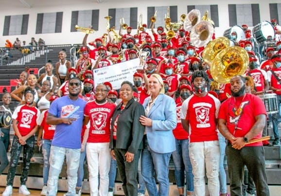 Amy Witherite and 1-800-TruckWreck Awarded $10,000 to Jonesboro High School as part of the 2021 (Inaugural) 1-800-TruckWreck Great Atlanta High School Band Challenge.