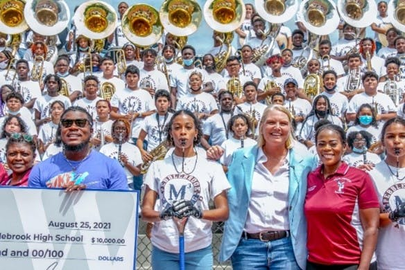 Amy Witherite and 1-800-TruckWreck awarded $10,000 to Pebblebrook High School as part of the 2021 (Inaugural) 1-800-TruckWreck Great Atlanta High School Band Challenge