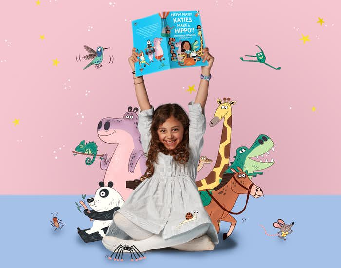 Girl holding her book surrounded by animal illustrations