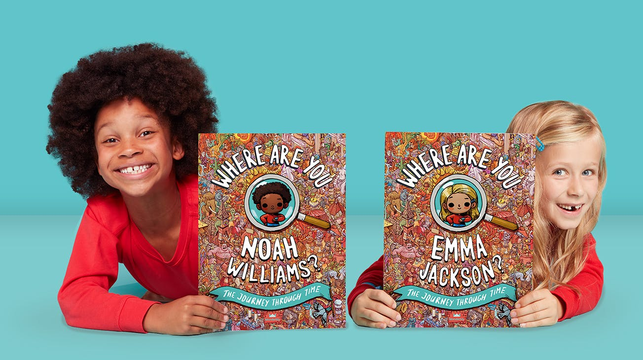 A boy and girl holding personalised copies of Where Are You...? The Journey Through Time
