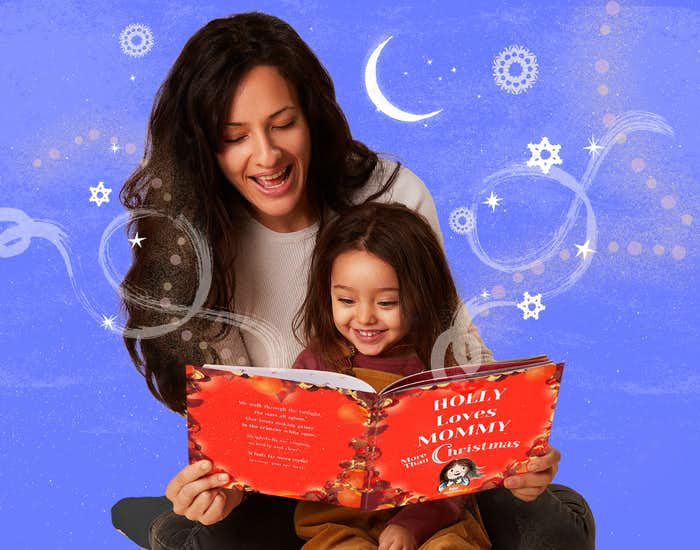 Mother and daughter reading I Love Mommy More Than Christmas
