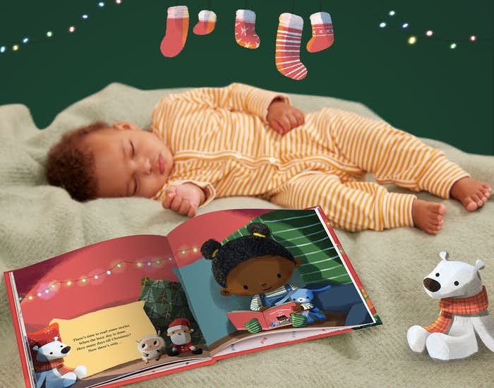 Baby sleeping next to the book