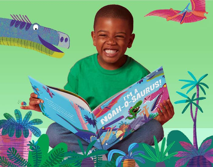 Child reading the book and smiling
