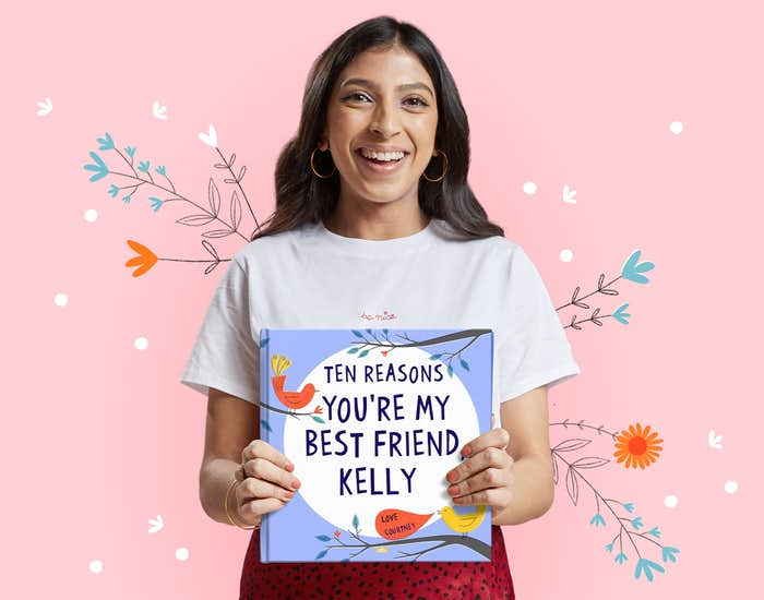 Woman holding her copy of Ten Reasons You're My Best Friend