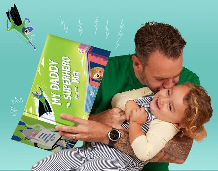 Father and daughter reading My Daddy The Superhero together