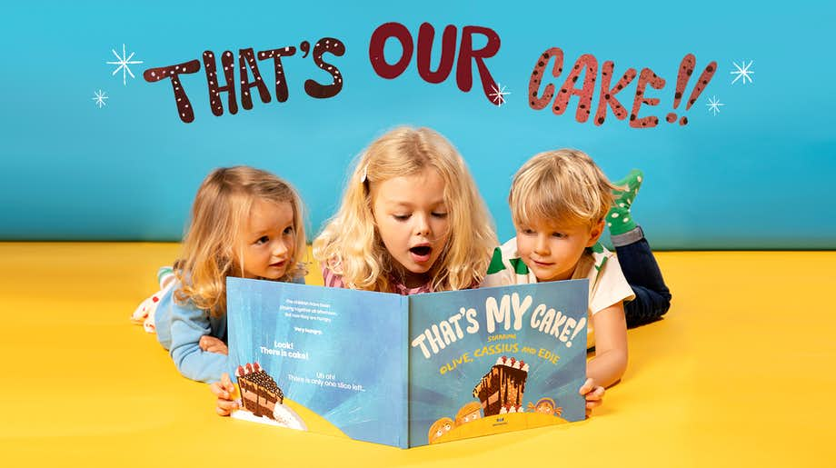 Siblings reading That's My Cake