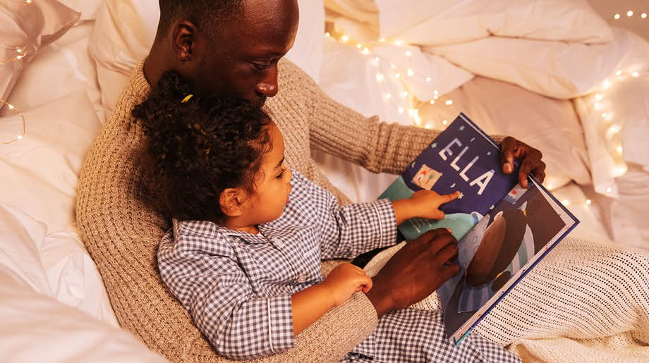 Father and child reading Bedtime For You