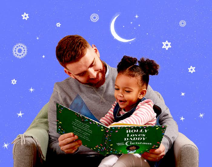 Father and daughter reading I Love Daddy More Than Christmas