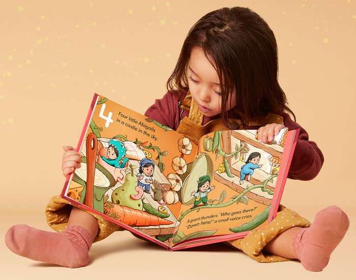 Little girl reading 10 Little Yous