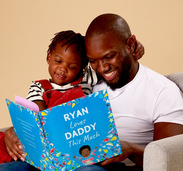A dad reading a book to his child