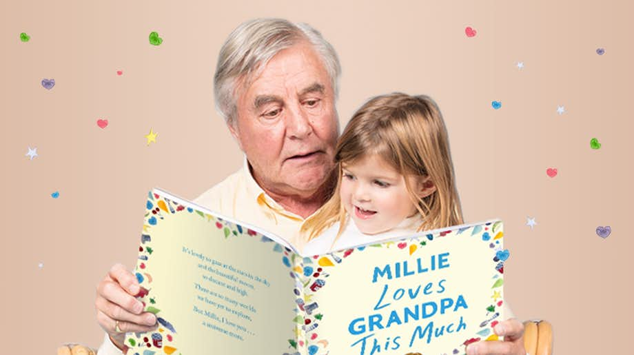 Grandpa and grandchild reading You Love Grandpa This Much