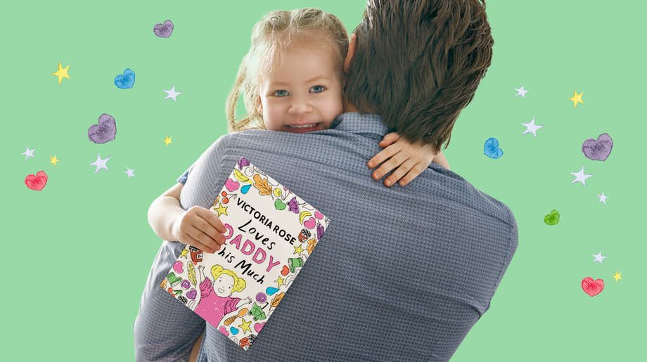 Father and daughter with personalized Father's day card