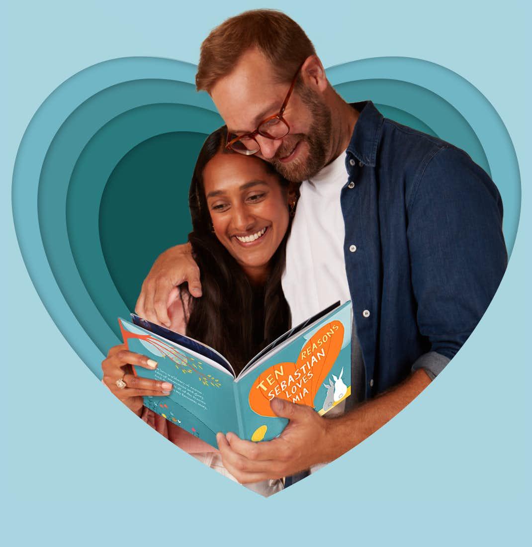 A couple reading Ten Reasons I Love You