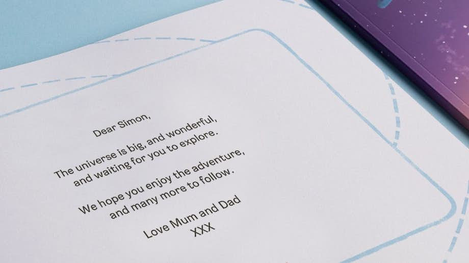 Zoomed-in image of the personalized dedication from Mum and Dad to their son, Simon