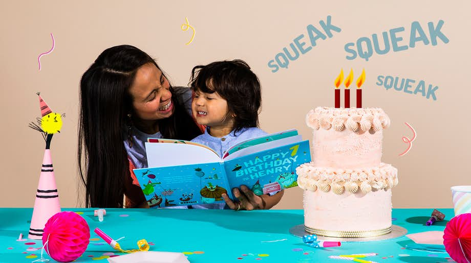 Mother and child reading Happy Birthday To You