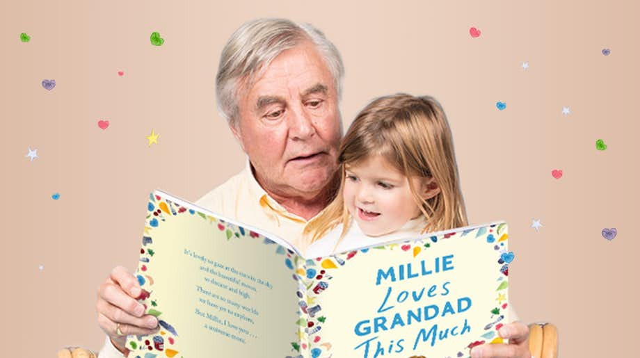 Grandad and grandchild reading You Love Grandad This Much