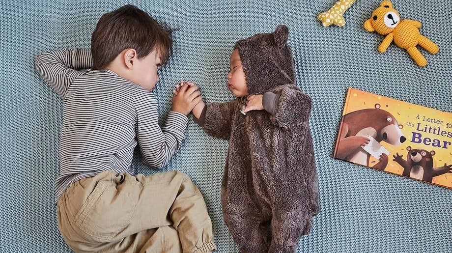 Kids holding A Letter for the Littlest Bear
