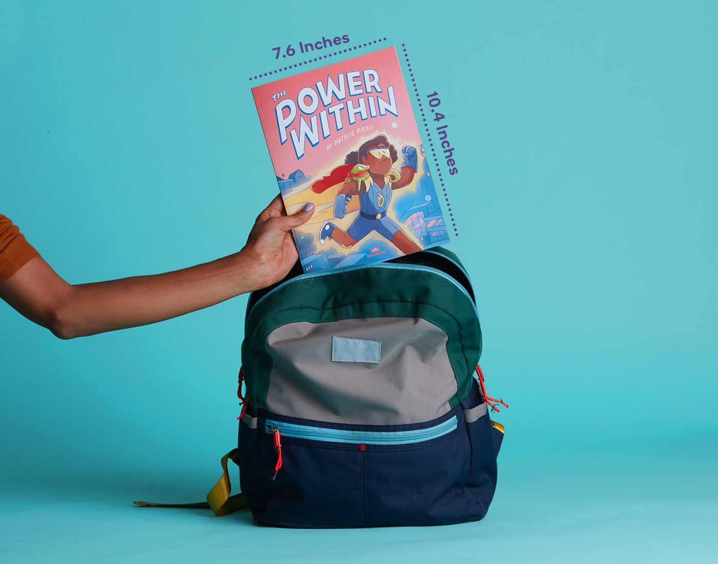 The Power Within personalized book size 7.6 inches by 10.4 inches being placed in backpack