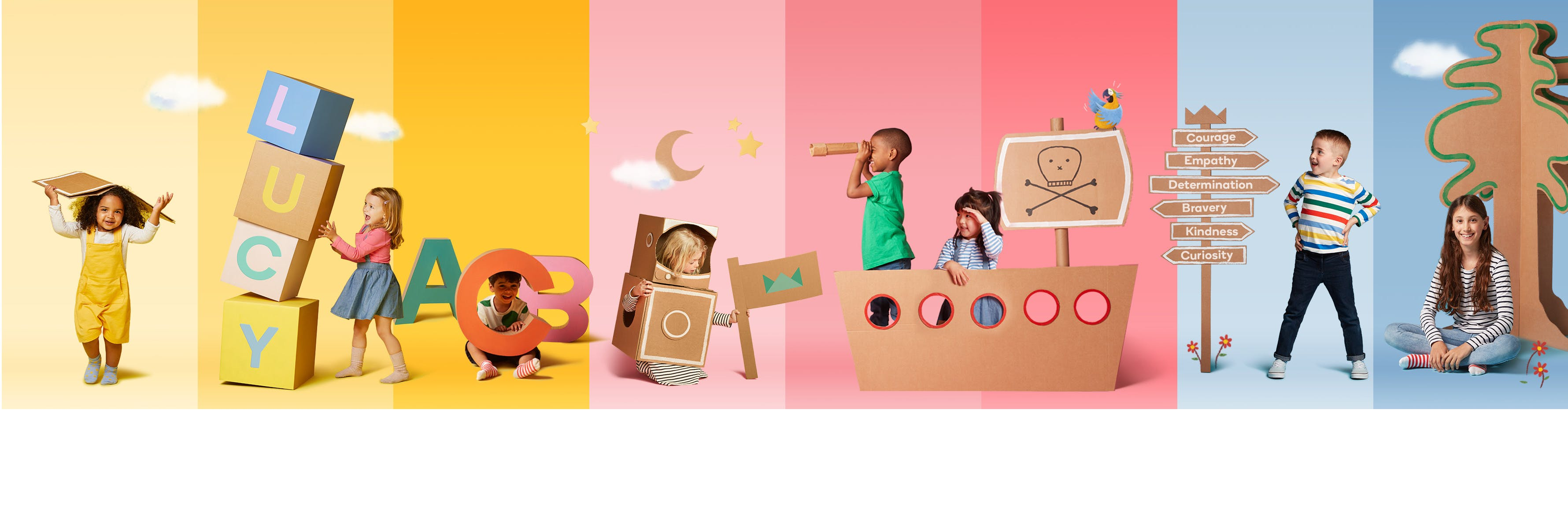 Children with cardboard books and letters