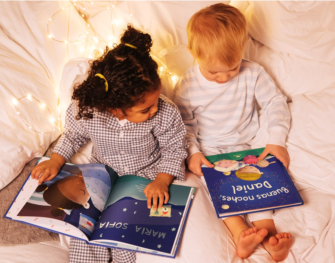 Two children looking at a book - Bedtime For You in Spanish