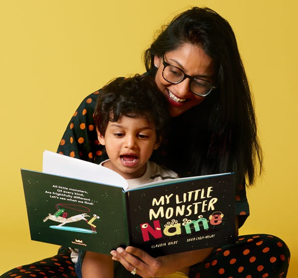 A child with their mum reading one of our books