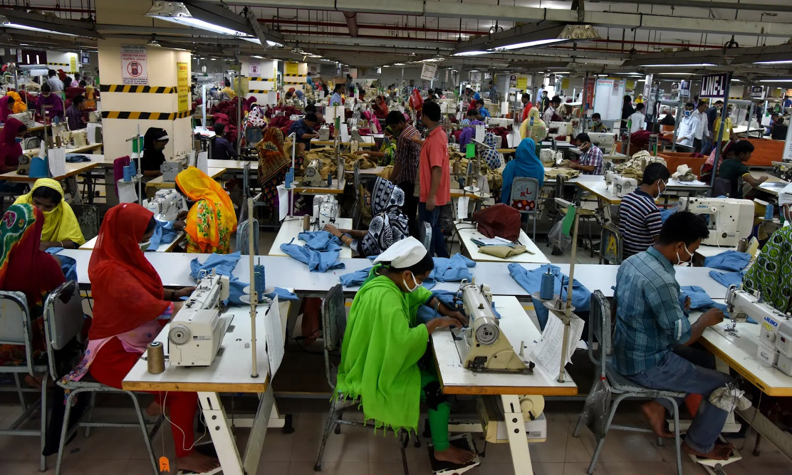 Garment workers tightly packed into a factory in Dhaka, Bangladesh. Photograph by NurPhoto via Getty Images