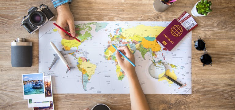 Planning a family holiday with a global map.