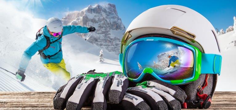 Ski equipment including white helmet, blue goggles and white and black gloves.