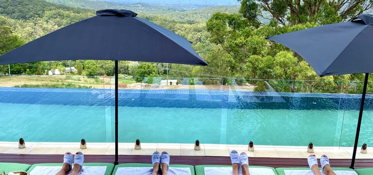 Girls by the pool at On Eagle Wings Mountain Retreat and Spa, Queensland.
