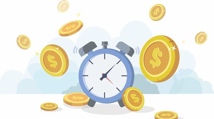 Kreditauszahlung in Echtzeit und ein Wecker mit Goldmünzen