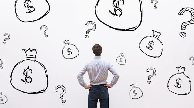 Kreditarten: Fragezeichen und Geldsäcke