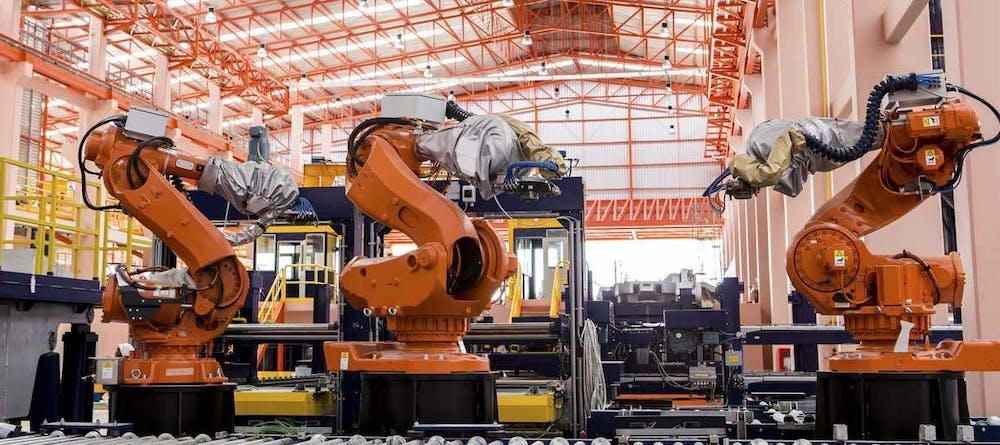 Large robots on assembly line