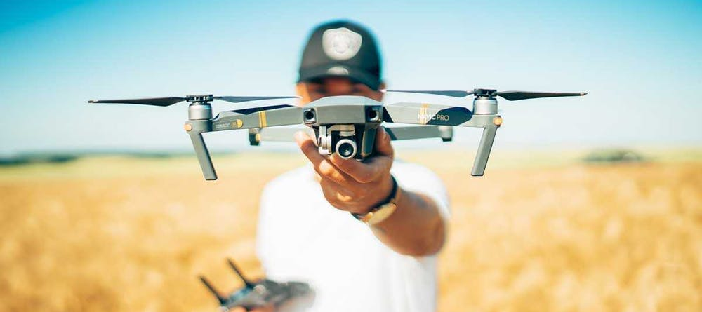 Man holding an advanced drone