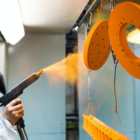 Powder coating metal parts