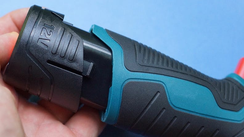 An overmolded handle on a power drill