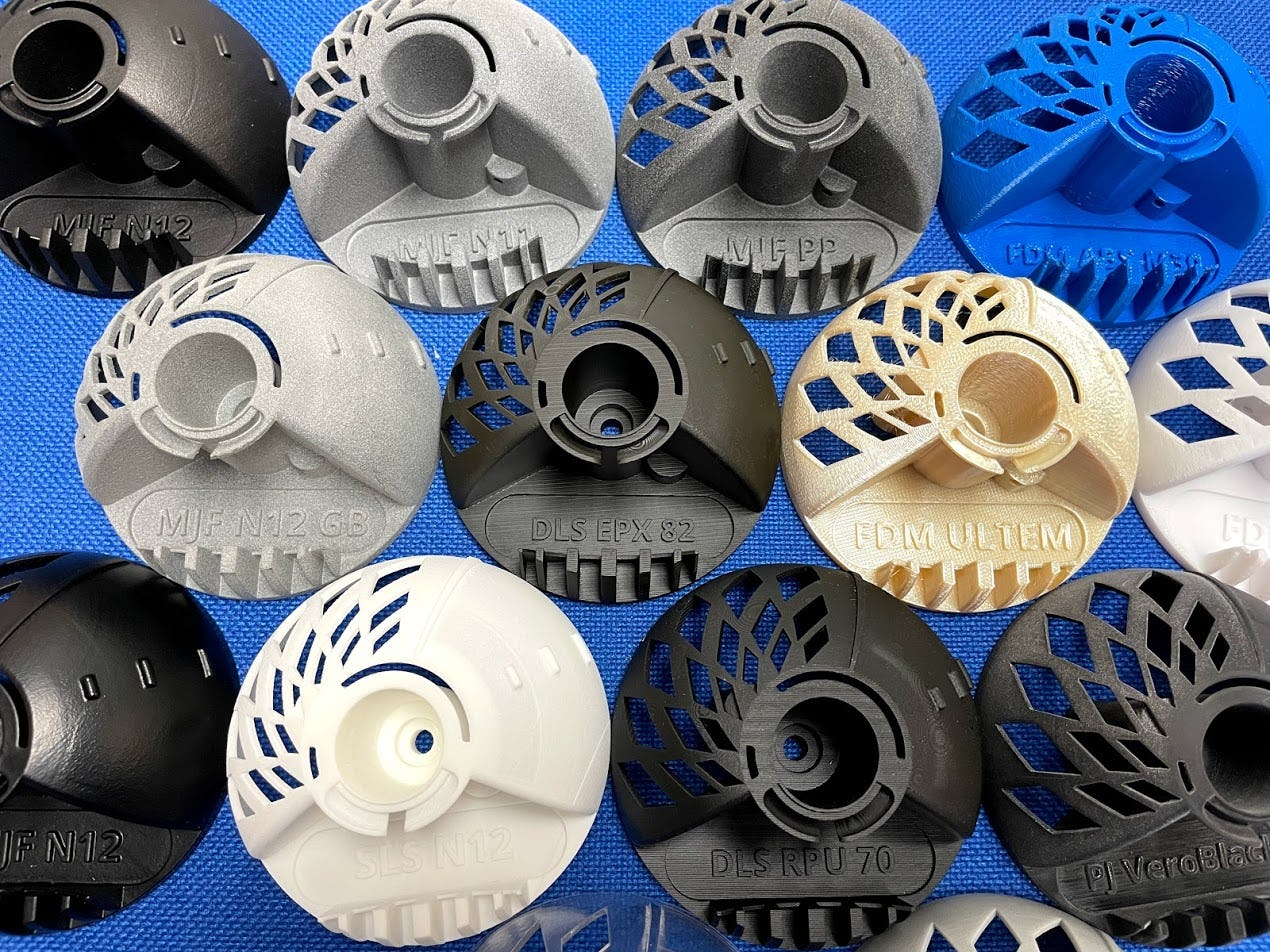 Parts made in different 3D printing materials and processes