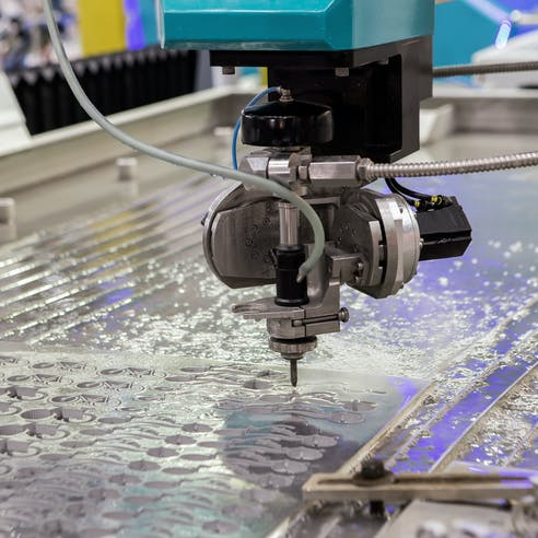 A water jet cutting machine at work