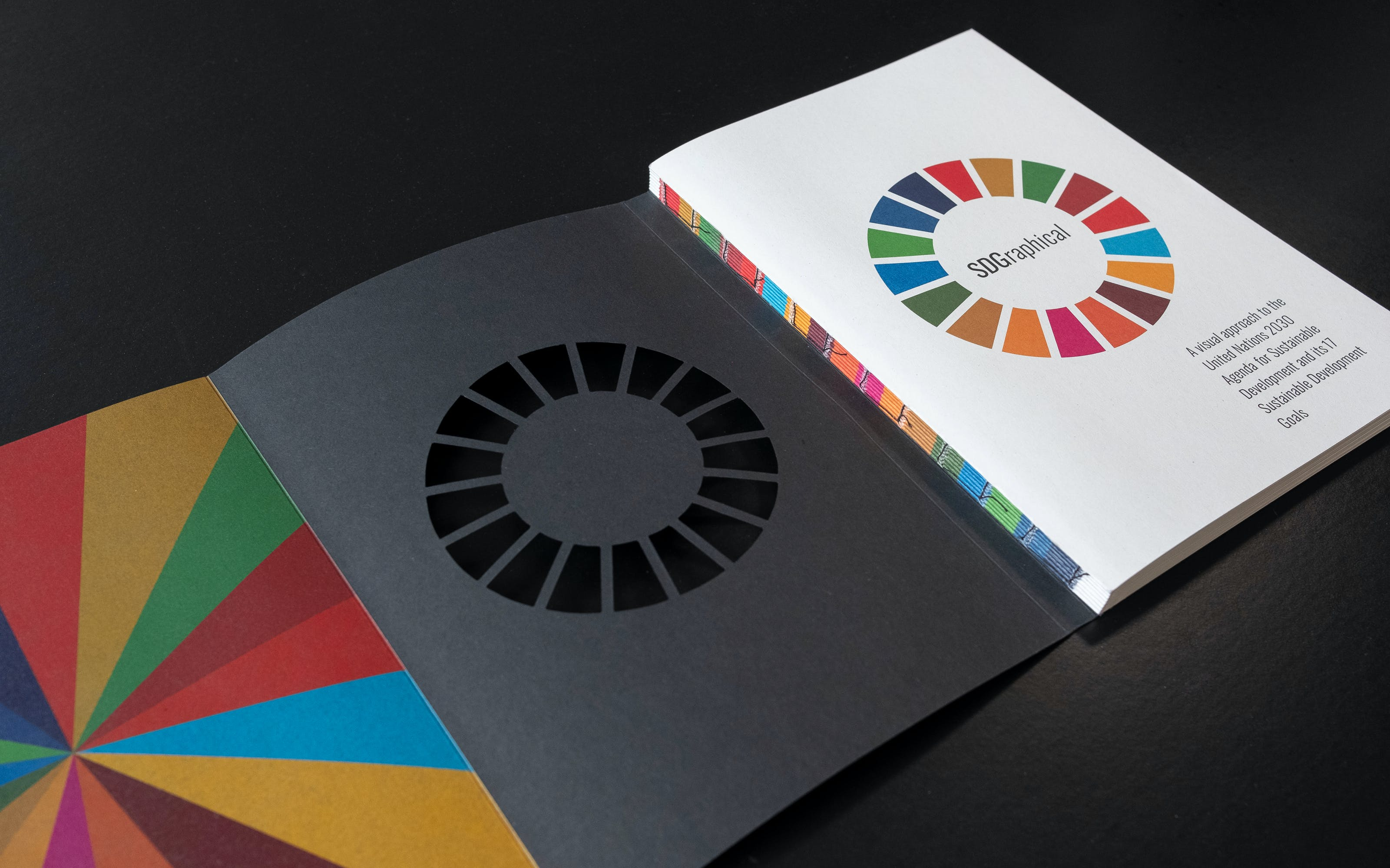 The 2030 Agenda is one of the largest projects of the United Nations, as it seeks to significantly improve and measure a wide range of global issues from the environment to inequality. SDGraphics makes an important contribution to the question of how to communicate the progress of this agenda. With its appealing aesthetics and high-quality, sustainable production, it encourages engagement with the data it presents and appeals to statisticians and the general public.