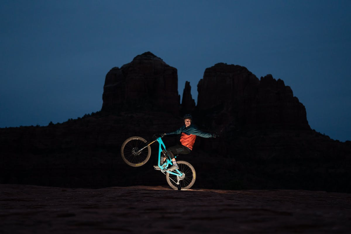 Marty Schaffer doing a one handed wheelie at night in Sedona
