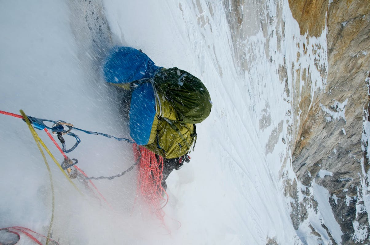 Renan Ozturk sheltering from sluff while climbing