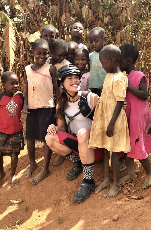Nichole Baker with a crowd of children during her work in Uganda.