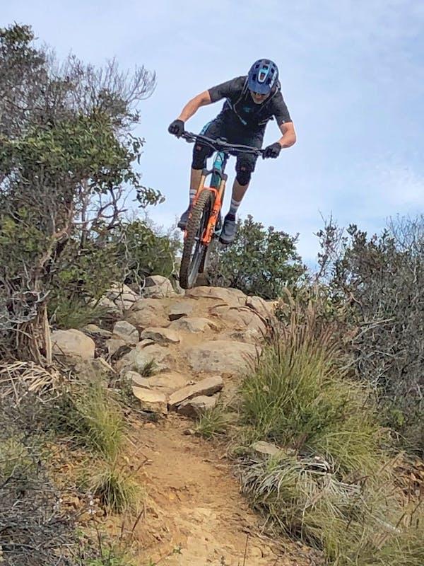 Joe Lawwill jumping over a rock garden