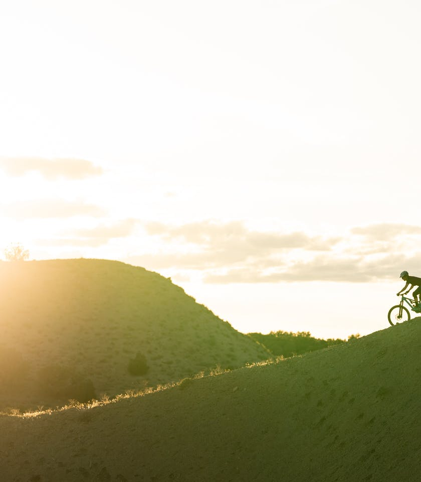 Liz Cunningham riding a ridge in Fruita