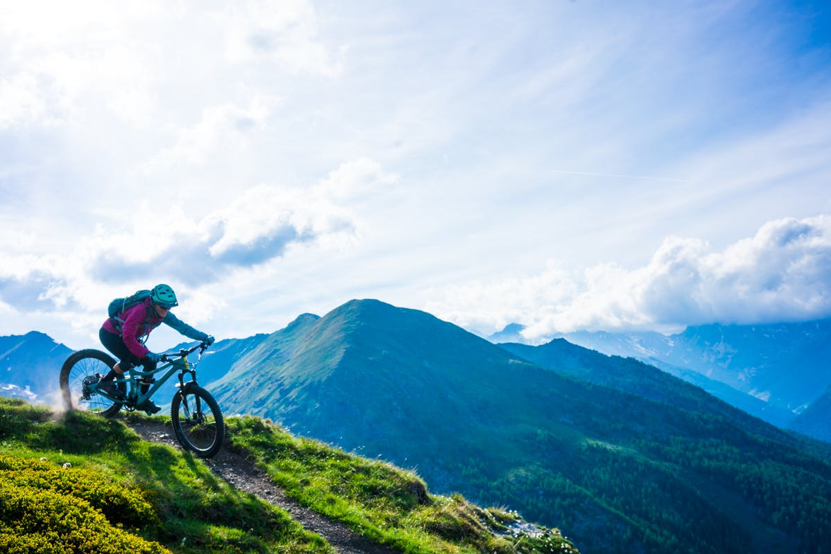 Britt Greer riding single track in Aosta, IT