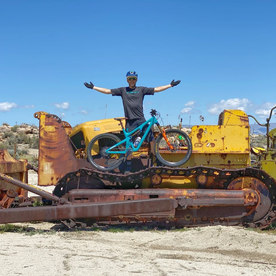 Joe Lawwill posing on heavy machinery